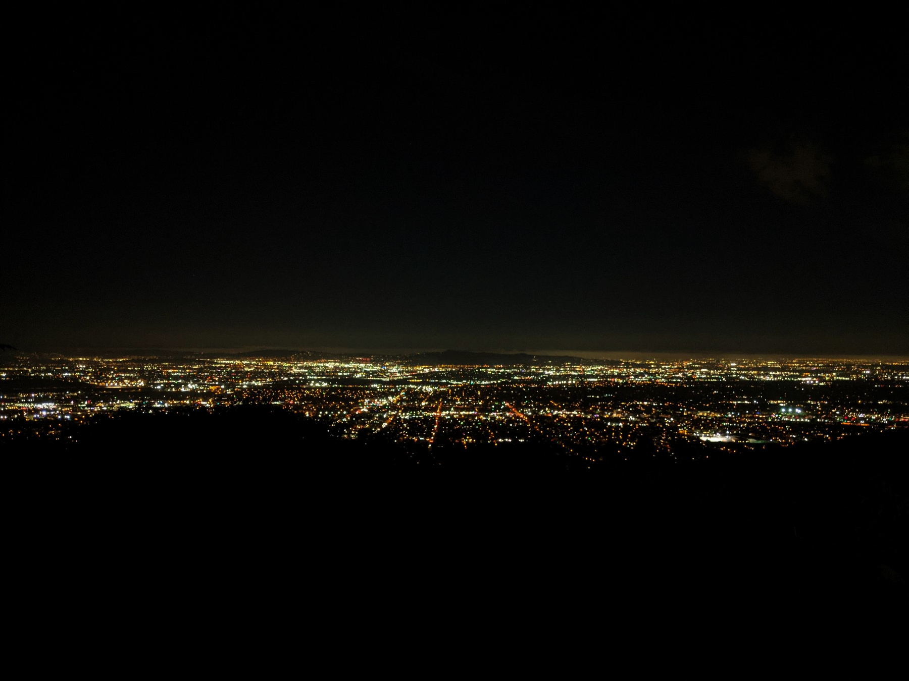 A photo looking out over Los Angeles county at night.